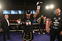 Fuaad Husseen (black shorts) defeats Ricky Starkey at the Woodside Leisure Centre on 9th March 2019