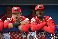 Batavia Muckdogs Victor Castro (40) and Javier Lopez (22) in the dugout before a game against the Lowell Spinners on July 17, 2014 at Dwyer Stadium in Batavia, New York.  Batavia defeated Lowell 4-3.  (Mike Janes/Four Seam Images)