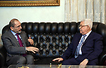 Palestinian President Mahmoud Abbas meets with Jordanian Foreign Minister Ayman Safadi, in Amman, Jordan, on May 5, 2018. Photo by Thaer Ganaim