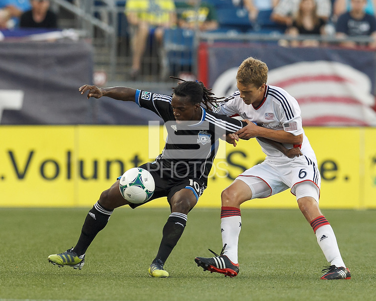 San Jose Earthquakes midfielder Walter Martinez (10) attempts to control the ball as New England Revolution midfielder Scott Caldwell (6) defends. In a Major League Soccer (MLS) match, the New England Revolution (white) defeated San Jose Earthquakes (black), 2-0, at Gillette Stadium on July 6, 2013.