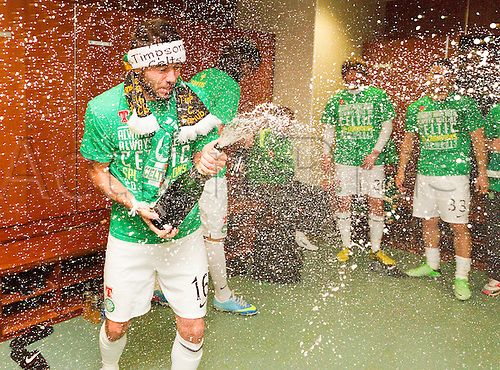 21.04.2013 Glasgow, Scotland. Joe Ledley cracks open the champagne in the Celtic dressing room after the Scottish Premier League game between Celtic and Inverness Caledonian Thistle from Celtic Park.