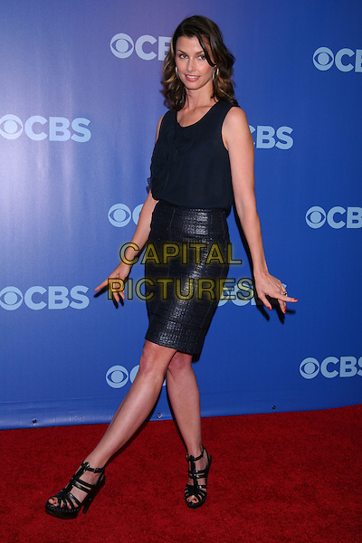 BRIDGET MOYNAHAN ('Blue Bloods') .2010 CBS Upfront (programming announcements) After-Party held in Damrosch Park, Lincoln Center, New York, NY, USA.        .May 19th, 2010     .full length black top skirt sleeveless sandals leg foot posing .CAP/LNC/TOM.©TOM/LNC/Capital Pictures.