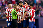 Players of Atletico de Madrid have words with the referee during La Liga match between Atletico de Madrid and Sevilla FC at Wanda Metropolitano Stadium in Madrid, Spain. March 07, 2020. (ALTERPHOTOS/A. Perez Meca)