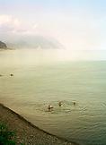 REPUBLIC OF GEORGIA, Batumi, people swimming in the Black Sea, Turkey in distance
