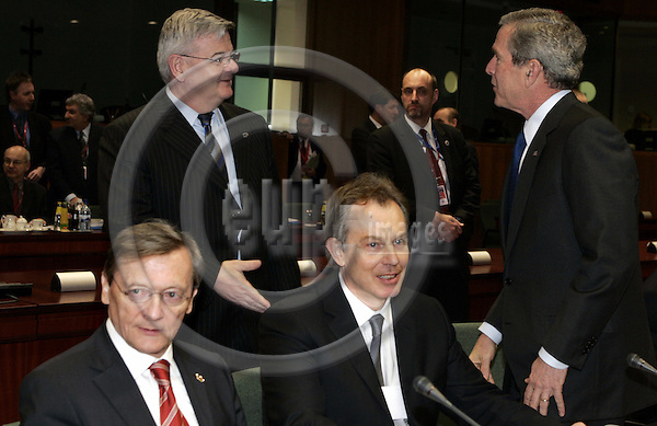 """BRUSSELS - BELGIUM - 22 FEBRUARY 2005 --EU-US Summit.--The President of the United States of America George W. BUSH greeting the German Minister of Foreign Affairs Joschka FISCHER (2ndL), who came to meeting of the Heads of State from the meeting of the Foreign Affairs Ministers. The Austrian Chancellor Wolfgang SCHÜSSEL (L) (Schuessel) with the British Prime Minister Tony BLAIR (C).--  PHOTO: JUHA ROININEN / EUP-IMAGES..This picture is copyright EUP-IMAGES and all rights belong to EUP-IMAGES. The picture may not be subject to RESALE or storage in any kind in electronical or analog way.  If published due to the above EU-US summit meeting in Brussels in print or electronical form the publication must inform on the use to the e-mail address """"eup@eup-images.com"""". All further use of this picture may only be done by contacting www.eup-images.com..."""