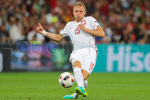 30.06.2016. Marseille, France. UEFA EURO 2016 quarter final match between Poland and Portugal at the Stade Velodrome in Marseille, France, 30 June 2016.   Kamil Glik (POL) with a shot on goal