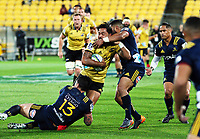 Matt Proctor is tackled during the Super Rugby match between the Hurricanes and Highlanders at Westpac Stadium in Wellington, New Zealand on Saturday, 24 March 2018. Photo: Mike Moran / lintottphoto.co.nz