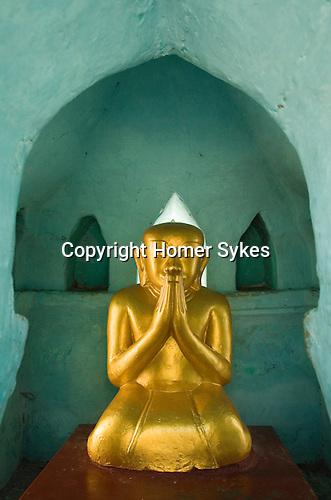 Small golden Budha. Shwezigon Pagoda Bagan. Myanmar (Burma.) 2006