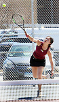 NAUGATUCK CT. 17 April 2019-041719SV12-Nhi Nguyen of Sacred Heart serves to Catarina Rego of Naugatuck High during tennis action in Naugatuck Wednesday.<br /> Steven Valenti Republican-American