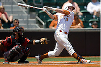 Catcher Kevin Lusson #14 of the Texas Longhorns YYY against Texas Tech on April 17, 2011 at UFCU Disch-Falk Field in Austin, Texas. (Photo by Andrew Woolley / Four Seam Images)