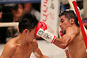 (L to R) Kazuto Ioka (JPN),  Juan Hernandez (Mex), AUGUST 10, 2011 - Boxing : Juan Hernandez of Mexico hits Kazuto Ioka of Japan during the WBC Minimum weight title bout at Korakuen Hall, Tokyo, Japan. Kazuto Ioka of Japan won the fight on points after twelve rounds. (Photo by Yusuke Nakanishi/AFLO) [1090]