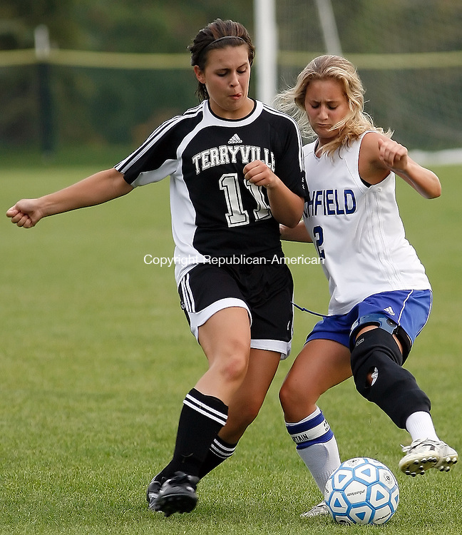 Litchfield, CT-27 September 2007-092707MK06 Litchfield's #2 Elizabeth Bindstadt battles for the ball against Terryville's #11 Shelby Bissonette during Berkshire League girls soccer action  at Litchfield High School Thursday afternoon  Terryville defeated Litchfield two - nil.  Michael Kabelka / Republican-American   (Litchfield's #2 Elizabeth Bindstadt battles for the ball against Terryville's #11 Shelby Bissonette)CQ