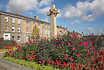 War memorial and flower beds with Georgian terrace houses behind, Bury St Edmunds, Suffolk, England Flower beds and Georgian terraced housing, Bury St Edmunds, Suffolk, England