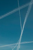 Contrails or water condensation trails from an aircraft's jet engines, high above the Southeast of England.