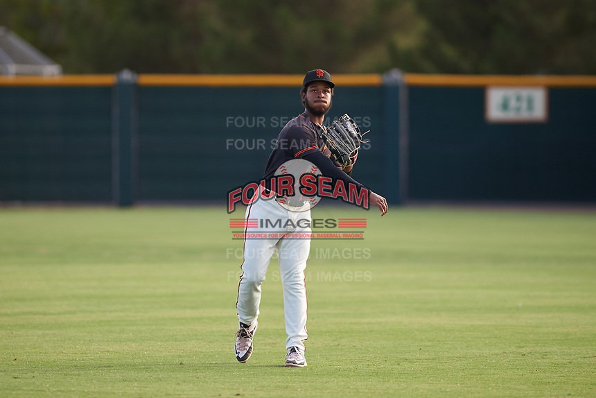 AZL Giants Black right fielder Jairo Pomares (16) warms up between innings of an Arizona League game against the AZL Giants Orange on July 19, 2019 at the Giants Baseball Complex in Scottsdale, Arizona. The AZL Giants Black defeated the AZL Giants Orange 8-5. (Zachary Lucy/Four Seam Images)