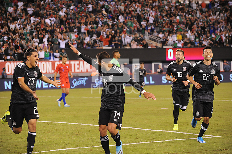EAST RUTHERFORD, NJ - SEPTEMBER 6: Erick Gutierrez #25 of Mexico celebrates his score with Javier Hernandez #14 of Mexico during a game between Mexico and USMNT at MetLife Stadium on September 6, 2019 in East Rutherford, New Jersey.