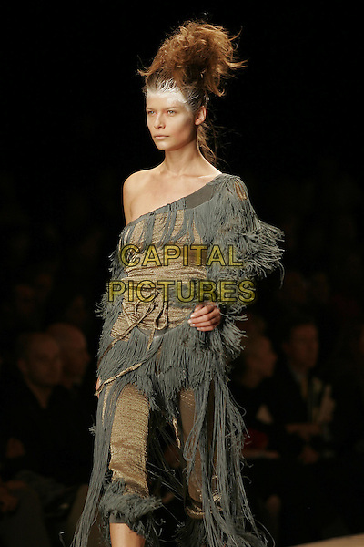 MODEL.Vivienne Westwood ready to wear Spring/Summer Collection 2005, Paris, France, .October 5th 2004..half length fashion show catwalk straw hat white hair powder talc khaki top cropped trousers long tassels.Ref: MDS.www.capitalpictures.com.sales@capitalpictures.com.©O.Medias/Capital Pictures .