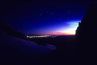Seattle city lights announce the sunrise at Camp Sherman, Mt Rainier, Washington, USA