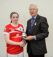 20th September 2014; <br /> GAA Handball President Willie Roche presents the gold medal to Catriona Casey of Cork<br /> M Donnelly All-Ireland Ladies 60x30 Handball Singes Final<br /> Catriona Casey (Cork) v Martina McMahon (Limerick) . <br /> Abbeylara, Co Longford<br /> Picture credit: Tommy Grealy/actionshots.ie