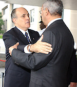 United States Secretary of State Colin Powell, right, and former New York Mayor Rudy Giuliani, left, embrace after making departure statements following their meeting at the State Department in Washington, DC on June 13, 2003.  Powell announced Giuliani will lead a Bush administration delegation to a conference called to address rising incidents of anti-semitism in Europe. .Credit: Ron Sachs / CNP.(RESTRICTION: NO New York or New Jersey Newspapers or newspapers within a 75 mile radius of New York City)