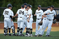 The Wake Forest Demon Deacons take the field prior to the game against the Davidson Wildcats at David F. Couch Ballpark on May 7, 2019 in  Winston-Salem, North Carolina. The Demon Deacons defeated the Wildcats 11-8. (Brian Westerholt/Four Seam Images)