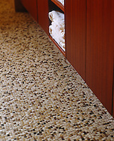 Detail of the pre-patterned mosaic tiles used to cover the bathroom floor