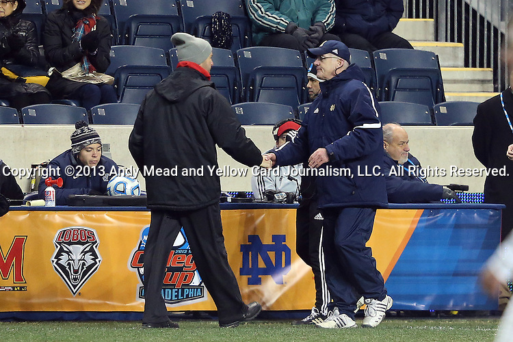 13 December 2013: Notre Dame head coach Bobby Clark (SCO) (right) and New Mexico head coach Jeremy Fishbein (left) shake hands after the game. The University of Notre Dame Fighting Irish played the University of New Mexico Lobos at PPL Park in Chester, Pennsylvania in a 2013 NCAA Division I Men's College Cup semifinal match. Notre Dame won the game 2-0.