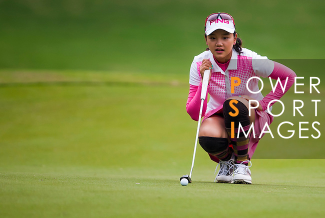 Yuting Shi of China lines up a putt during the Hyundai China Ladies Open 2014 on December 10 2014 at Mission Hills Shenzhen, in Shenzhen, China. Photo by Xaume Olleros / Power Sport Images