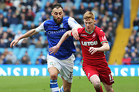 Sam Clucas of Swansea City (R) closely followed by Atdhe Nuhiu of Sheffield Wednesday during The Emirates FA Cup Fifth Round match between Sheffield Wednesday and Swansea City at Hillsborough, Sheffield, England, UK. Saturday 17 February 2018
