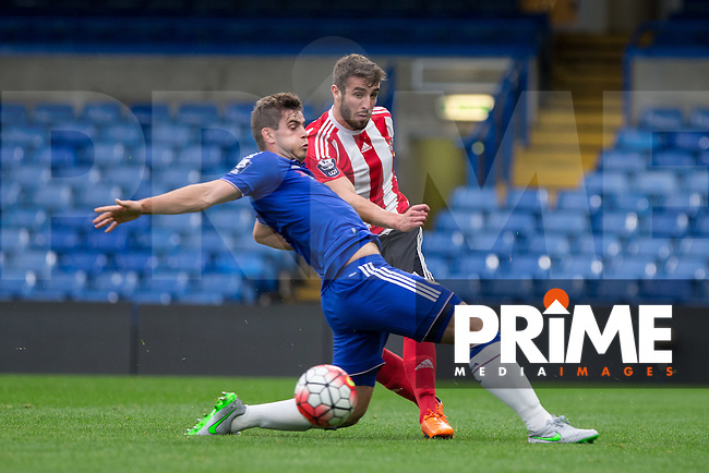 Sam McQueen of Southampton U21 hits the ball past Dion Conroy of Chelsea U21 during the Barclays Under-21 Premier League match between Chelsea U21 and Southampton U21 at Stamford Bridge, London, England on 14 August 2015. Photo by Andy Rowland.