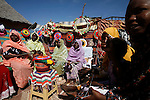 Darfuri women weave traditional products in Klaimendo village in North Darfur, 05 Dec, 2008. Despite the fact that North Darfur is believed to currently have the highest concentration of NGOs in the world, the creation of Klaimendo district and village is the work of people born and raised in the area, rather than an outside aid agency. (John D McHugh)