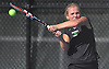 Lauren Hutton of Harborfields returns a shot from Daniela Tedoldi of Smithtown West during the Suffolk County girls tennis Division I singles consolation final at Half Hollow Hills West High School on Tuesday, Oct. 11, 2016.