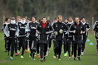 FAO SPORTS PICTURE DESK<br /> Pictured L-R: Leroy Lita, Garry Monk, coach and Gerhard Tremmel lead the way warming up. Tuesday 17 January 2012<br /> Re: Premier League side Swansea City Football Club training in Llandarcy, south Wales.