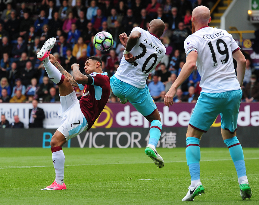 Burnley's Andre Gray looks to lift the ball over West Ham United's Andre Ayew<br /> <br /> Photographer Andrew Vaughan/CameraSport<br /> <br /> The Premier League - Burnley v West Ham United - Sunday 21st May 2017 - Turf Moor - Burnley<br /> <br /> World Copyright &copy; 2017 CameraSport. All rights reserved. 43 Linden Ave. Countesthorpe. Leicester. England. LE8 5PG - Tel: +44 (0) 116 277 4147 - admin@camerasport.com - www.camerasport.com