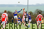 The Bernard O'Callaghan Memorial Senior Football Championship 2014 Quarter Final Brosna V St. Senan's, sponsored by McMunns Ballybunion, Saturday November 29th 2014. Held in Duagh. <br /> <br /> Brosna's Dave Curtin being challenged by St. Senan's players Jason Brown and Shane Nolan.