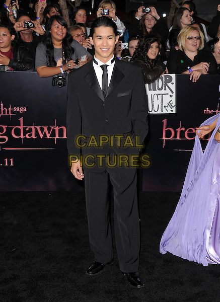 Booboo Stewart.The Los Angeles premiere of 'The Twilight Saga Breaking Dawn Part 1' at Nokia Theatre at L.A. Live in Los Angeles, California, USA..November 14th, 2011.full length black suit.CAP/RKE/DVS.©DVS/RockinExposures/Capital Pictures.
