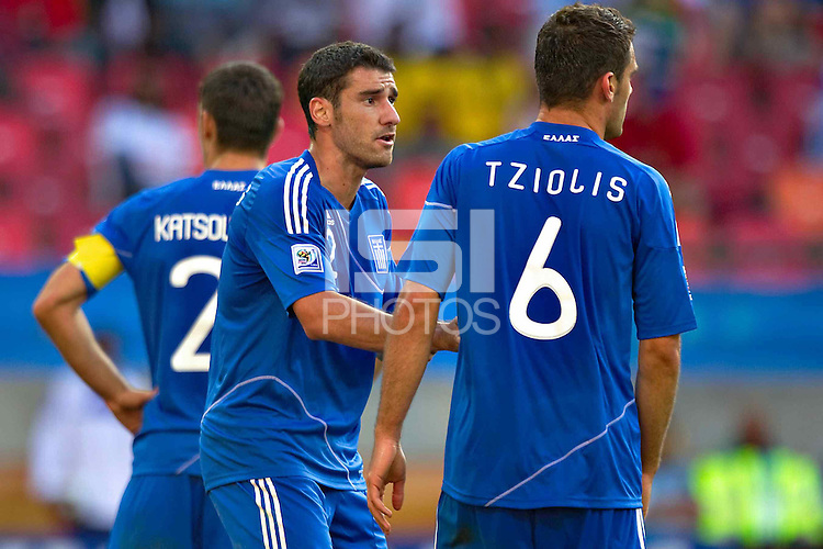 Georgios Seitaridis and Alexandros Tziolis of Greece stands dejected
