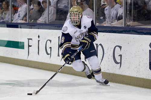 Notre Dame defenseman Sam Calabrese (#8) skates with the puck in first period action of NCAA hockey game between Notre Dame and Michigan.  The Notre Dame Fighting Irish  defeated the Michigan Wolverines 3-1 in game at the Compton Family Ice Arena in South Bend, Indiana.