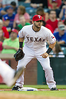 Texas Rangers first baseman Mitch Moreland #18 on defense during the Major League Baseball game against the Baltimore Orioles on August 21st, 2012 at the Rangers Ballpark in Arlington, Texas. The Orioles defeated the Rangers 5-3. (Andrew Woolley/Four Seam Images).
