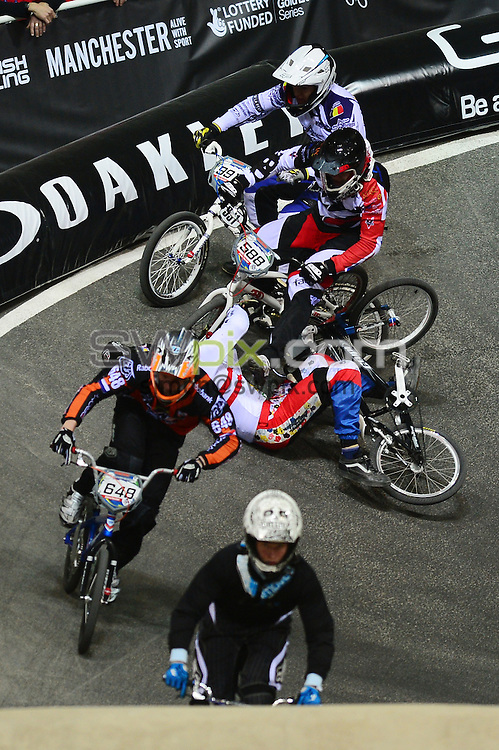 PICTURE BY ALEX BROADWAY/SWPIX.COM - Cycling - 2013 UCI BMX Supercross World Cup - National BMX Centre, Manchester, England - 19/04/13 - Tobias Franek of Austria, Ryan Bauer of Great Britain and Brian Warnier of Belgium crash out during the Manchester Cup heats.