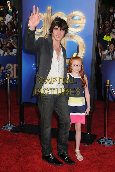 "Roy Frank ""RJ"" Mitte III & Lacianne Carriere.The 20th Century Fox 'Glee 3D' Concert World Movie Premiere held at The Regency Village theatre in Westwood, California, USA,.August 6th 2011..full length suit hand waving dress blue yellow pink black.CAP/ADM/BP.©Byron Purvis/AdMedia/Capital Pictures."