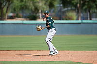 Oakland Athletics shortstop Jhoan Paulino (17) prepares to make a throw to first base during an Instructional League game against the Los Angeles Dodgers at Camelback Ranch on October 4, 2018 in Glendale, Arizona. (Zachary Lucy/Four Seam Images)