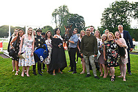 Connections of Lyrica's Lion celebrate in the winners enclosure after winning The Party Continues At The Chapel Nightclub Handicap, during Ladies Evening Racing at Salisbury Racecourse on 15th July 2017