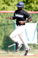 15 July 2011: Fred Hanvi of the Senart Templiers runs the bases after his solo homerun in the first inning during the 2011 Challenge de France match won 6-5 by the Rouen Huskies over the Senart Templiers at Stade Pierre Rolland, in Rouen, France.