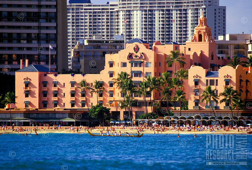 "The fabulous Royal Hawaiian Hotel or """"pink palace"""", an historic landmark in Waikiki Beach, viewed from the beautiful blue Pacific ocean."