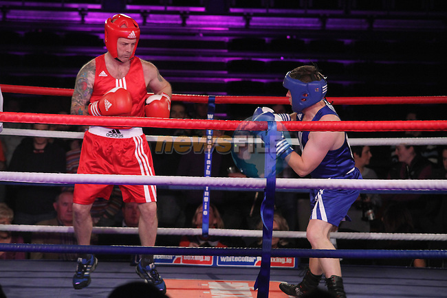 """Niall """"The Killer"""" Reynolds (red) sponsored by the Green Man Barbers and Ian McKeown """"The Liquidator"""" (blue) sponsored by McKeown and Associates taking part in Drogheda and District, """"Battle of the Barbican"""" White Collar Boxing Event in aid of the Des Smyth Foundation...(Photo credit should read Jenny Matthews www.newsfile.ie)....This Picture has been sent you under the conditions enclosed by:.Newsfile Ltd..The Studio,.Millmount Abbey,.Drogheda,.Co Meath..Ireland..Tel: +353(0)41-9871240.Fax: +353(0)41-9871260.GSM: +353(0)86-2500958.email: pictures@newsfile.ie.www.newsfile.ie."""