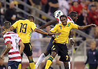 COLUMBUS, OHIO - SEPTEMBER 11, 2012:  Jozy Altidore (17) of the USA MNT goes up for a header against Adrian Mariappa (19) and Jason Morrison (7) of  Jamaica during a CONCACAF 2014 World Cup qualifying  match at Crew Stadium, in Columbus, Ohio on September 11. USA won 1-0.
