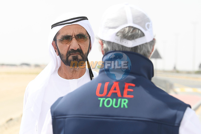 Sheikh Mohammed bin Rashid Al Maktoum watches the race pass by during Stage 4 of the 2019 UAE Tour, running 197km form The Pointe Palm Jumeirah to Hatta Dam, Dubai, United Arab Emirates. 26th February 2019.<br /> Picture: LaPresse/Fabio Ferrari | Cyclefile<br /> <br /> <br /> All photos usage must carry mandatory copyright credit (© Cyclefile | LaPresse/Fabio Ferrari)