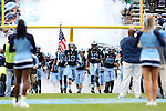 23 November 2013: UNC's Nick Weiler (19) and Marquise Williams (12) lead their teammates onto the field. The University of North Carolina Tar Heels played the Old Dominion University Monarchs at Keenan Stadium in Chapel Hill, NC in a 2013 NCAA Division I Football game. UNC won the game 80-20.