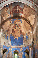 Pictures and images of the historic frescoes of St Nicholas Church interior in the medieval Kintsvisi Monastery Georgian Orthodox Monastery complex, depicting  the Virgin Mary also contains an enthroned Hodegetria with a Communion of the Apostles in iits apse. Shida Kartli Region, Georgia (country).